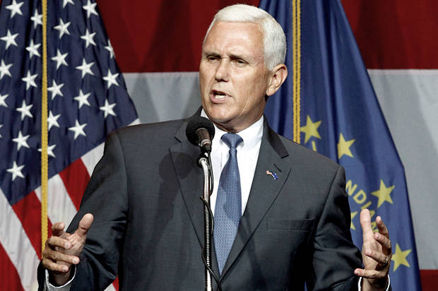 Indiana Governor Mike Pence addresses the crowd before Republican presidential candidate Donald Trump took the stage during a campaign stop at the Grand Park Events Center in Westfield